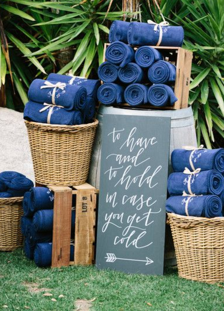 Blankets for guests at an outdoor wedding