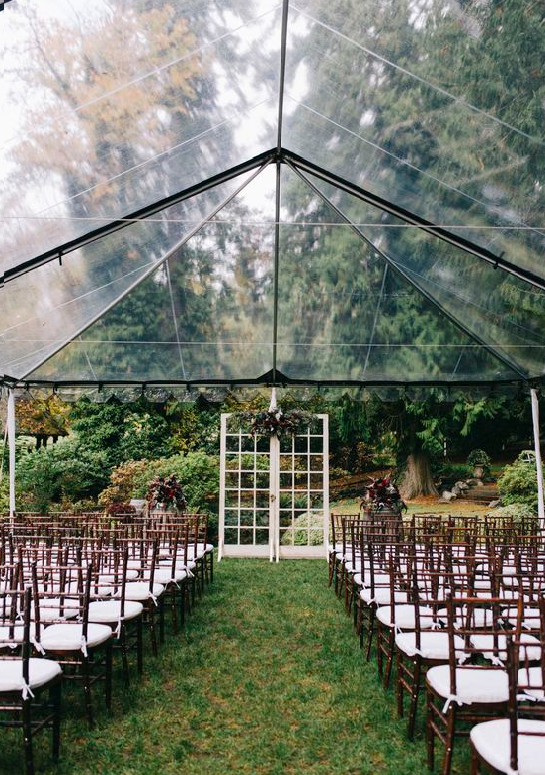 Outdoor wedding under a transparent marquee