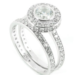 Rub Over Halo Engagement Rings with side diamonds & matching half-eternity wedding ring - front shot