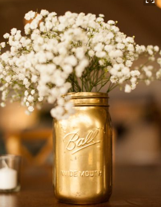 Golden Jars used as Vases for Wedding Table Centrepiece