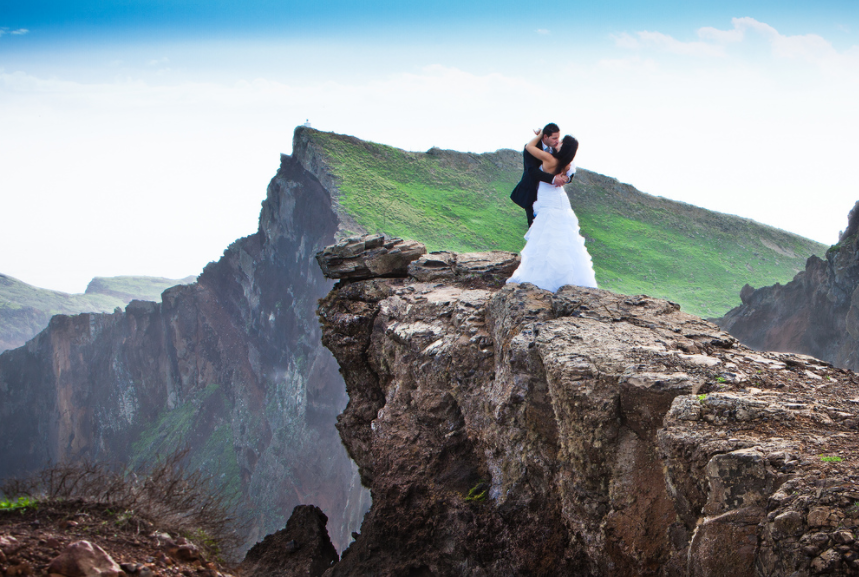 Bride and Groom kissing on top of a mountain in Madeira Island off Portugal