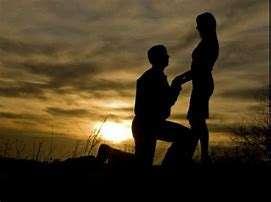 Romantic proposal at sunset.