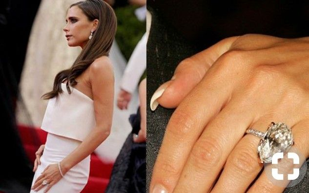 One of Victoria Beckham's 14 engagement rings. A marquise diamond solitaire.